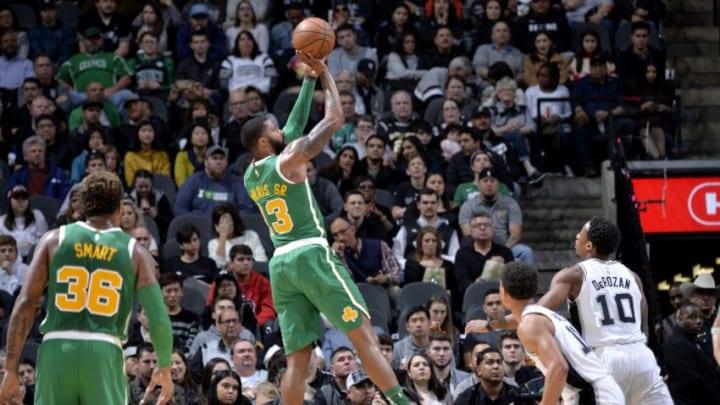 SAN ANTONIO, TX - DECEMBER 31: Marcus Morris #13 of the Boston Celtics shoots the ball against the San Antonio Spurs (Photos by Mark Sobhani/NBAE via Getty Images)