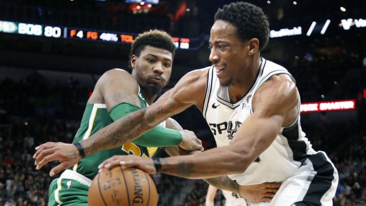SAN ANTONIO, TX – DECEMBER 31: DeMar DeRozan #10 of the San Antonio Spurs drives past Marcus Smart #36 of the Boston Celtics at AT&T Center on December 31, 2018 in San Antonio, Texas. (Photo by Ronald Cortes/Getty Images)