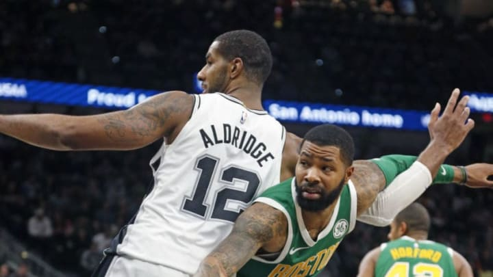 SAN ANTONIO, TX - DECEMBER 31: Marcus Morris #13 of the Boston Celtics tangles with LaMarcus Aldridge #12 of the San Antonio Spurs at AT&T Center on December 31, 2018 in San Antonio, Texas. NOTE TO USER: User expressly acknowledges and agrees that , by downloading and or using this photograph, User is consenting to the terms and conditions of the Getty Images License Agreement. (Photo by Ronald Cortes/Getty Images)