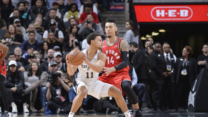 SAN ANTONIO, TX – JANUARY 3: Bryn Forbes #11 of the San Antonio Spurs handles the ball against Danny Green #14 of the Toronto Raptors (Photos by Mark Sobhani/NBAE via Getty Images)