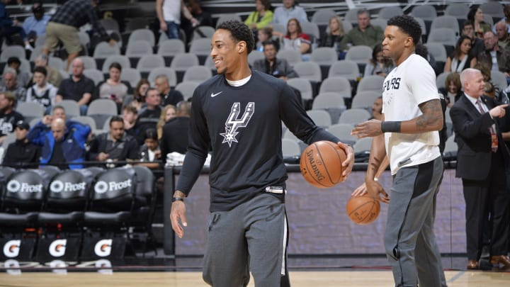 SAN ANTONIO, TX – JANUARY 5: DeMar DeRozan #10 of the San Antonio Spurs and Rudy Gay #22 of the San Antonio Spurs warms up prior to the game against the Memphis Grizzlies (Photos by Mark Sobhani/NBAE via Getty Images)