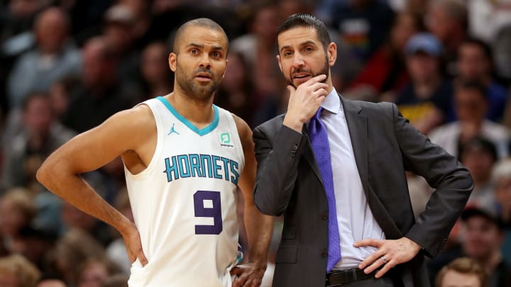DENVER, COLORADO – JANUARY 5: Former San Antonio Spurs Tony Parker #9 and head coach James Borrego against the Denver Nuggets at the Pepsi Center. (Photo by Matthew Stockman/Getty Images)