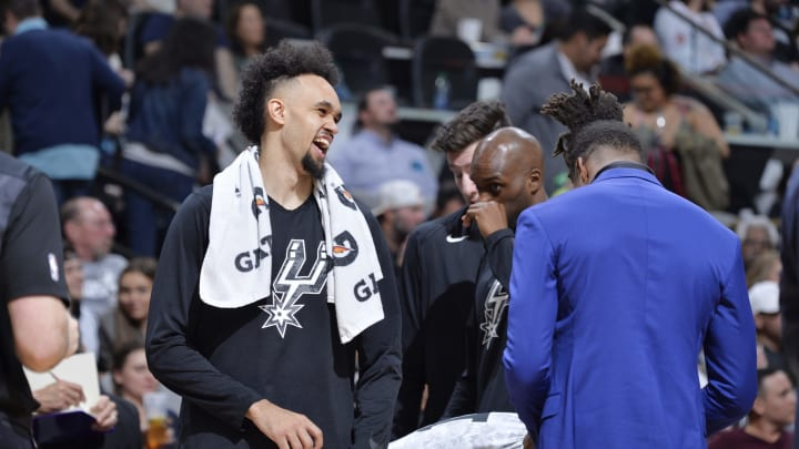 SAN ANTONIO, TX – JANUARY 5: Derrick White #4 of the San Antonio Spurs laughs from the bench during the game against the Memphis Grizzlies on January 5, 2019 at the AT&T Center in San Antonio, Texas. (Photos by Mark Sobhani/NBAE via Getty Images)