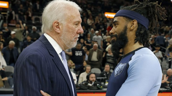 SAN ANTONIO, TX – JANUARY 5: Gregg Popovich head coach of the San Antonio Spurs talks with Mike Conley #11 of the Memphis Grizzlies after an NBA game held January 5, 2019 (Photo by Edward A. Ornelas/Getty Images)