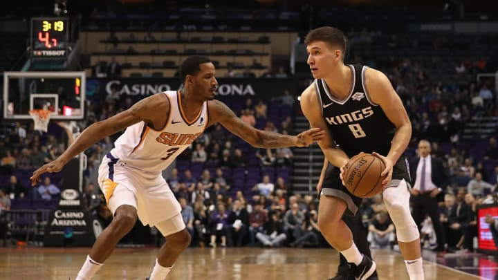 PHOENIX, ARIZONA – DECEMBER 04: Bogdan Bogdanovic #8 of the Sacramento Kings handles the ball against Trevor Ariza #3 of the Phoenix Suns during the first half of the NBA game at Talking Stick Resort Arena on December 4, 2018 in Phoenix, Arizona. (Photo by Christian Petersen/Getty Images)