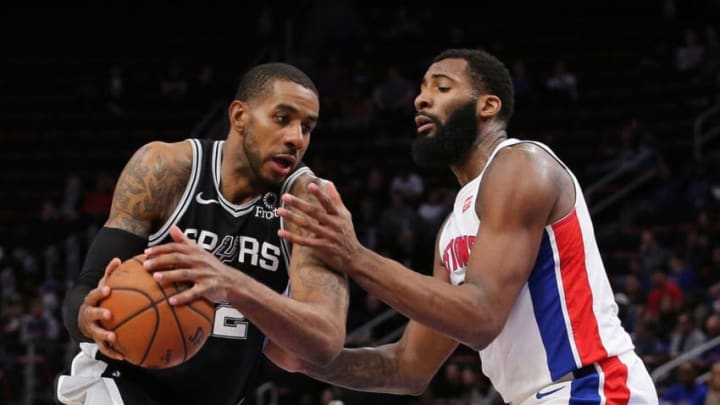 DETROIT, MI - JANUARY 7: LaMarcus Aldridge #12 of the San Antonio Spurs drives the ball to the basket during the fourth quarter as Andre Drummond #0 of the Detroit Pistons defends at Little Caesars Arena (Photo by Leon Halip/Getty Images)
