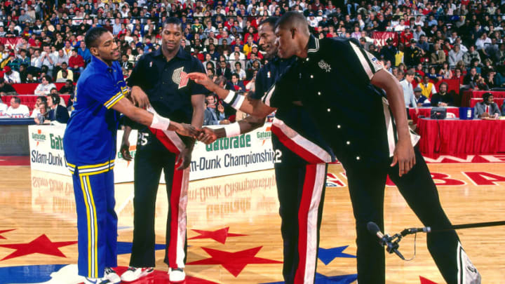CHICAGO, IL - FEBRUARY 6: Otis Smith #18 of the Golden State Warriors and Greg Anderson #33 of the San Antonio Spurs shake hands during the 1988 NBA Slam Dunk Contest on February 6, 1988 at the Chicago Stadium in Chicago, Illinois. NOTE TO USER: User expressly acknowledges and agrees that, by downloading and/or using this photograph, user is consenting to the terms and conditions of the Getty Images License Agreement. Mandatory Copyright Notice: Copyright 1988 NBAE (Photo by Andrew D. Bernstein/NBAE via Getty Images)