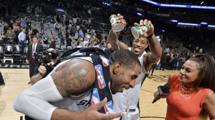 SAN ANTONIO, TX - JANUARY 10: DeMar DeRozan #10 of the San Antonio Spurs pours water on teammate LaMarcus Aldridge #12 of the San Antonio Spurs following the game agains the Oklahoma City Thunder on January 10, 2019 at the AT&T Center in San Antonio, Texas. NOTE TO USER: User expressly acknowledges and agrees that, by downloading and or using this photograph, user is consenting to the terms and conditions of the Getty Images License Agreement. Mandatory Copyright Notice: Copyright 2019 NBAE (Photos by Mark Sobhani/NBAE via Getty Images)