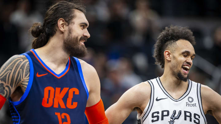 SAN ANTONIO, TX – JANUARY 10: Steven Adams #12 of the Oklahoma City Thunder, and Derrick White #4 of the San Antonio Spurs are seen smiling (Photos by Zach Beeker/NBAE via Getty Images)