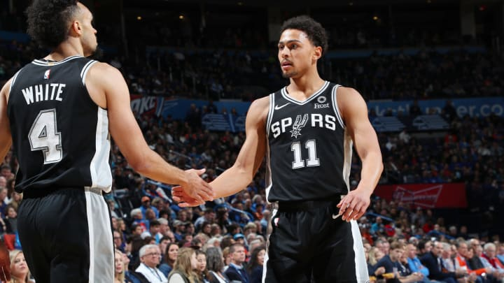 OKLAHOMA CITY, OK- JANUARY 12: Bryn Forbes #11 celebrates with Derrick White #4 of the San Antonio Spurs during the game against the Oklahoma City Thunder on January 12, 2019 (Photo by Zach Beeker/NBAE via Getty Images)