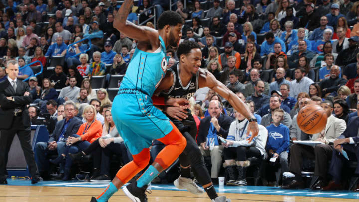 OKLAHOMA CITY, OK- JANUARY 12: Paul George #13 of the Oklahoma City Thunder and DeMar DeRozan #10 of the San Antonio Spurs battle for control of the ball during the game on January 12, 2019 at Chesapeake Energy Arena in Oklahoma City, Oklahoma. NOTE TO USER: User expressly acknowledges and agrees that, by downloading and or using this photograph, User is consenting to the terms and conditions of the Getty Images License Agreement. Mandatory Copyright Notice: Copyright 2019 NBAE (Photo by Zach Beeker/NBAE via Getty Images)