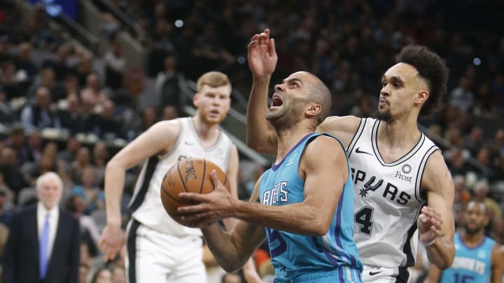 SAN ANTONIO, TX – JANUARY 14: Tony Parker #9 of the Charlotte Hornets drives past Derrick White #4 of the San Antonio Spurs at AT&T Center on January 14, 2019 in San Antonio, Texas. (Photo by Ronald Cortes/Getty Images)