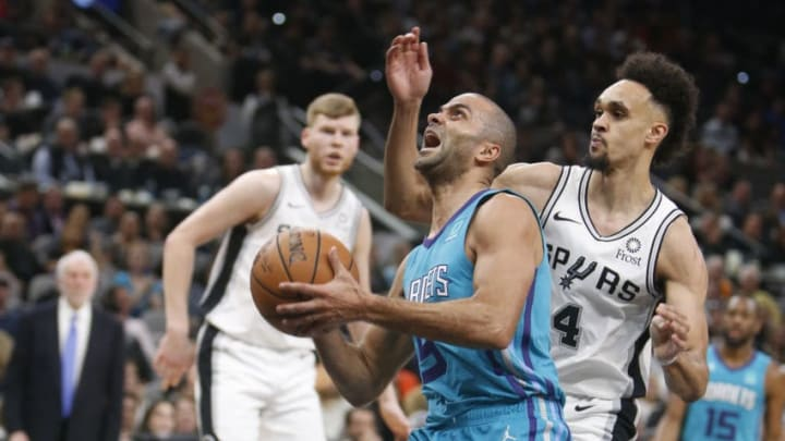 SAN ANTONIO, TX - JANUARY 14: Tony Parker #9 of the Charlotte Hornets drives past Derrick White #4 of the San Antonio Spurs at AT&T Center on January 14, 2019 in San Antonio, Texas. NOTE TO USER: User expressly acknowledges and agrees that , by downloading and or using this photograph, User is consenting to the terms and conditions of the Getty Images License Agreement. (Photo by Ronald Cortes/Getty Images)