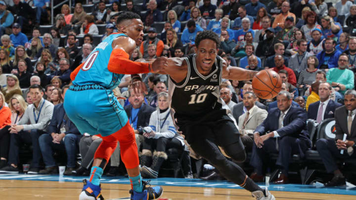 OKLAHOMA CITY, OK- JANUARY 12: DeMar DeRozan #10 of the San Antonio Spurs handles the ball against the Oklahoma City Thunder on January 12, 2019 at Chesapeake Energy Arena in Oklahoma City, Oklahoma. NOTE TO USER: User expressly acknowledges and agrees that, by downloading and or using this photograph, User is consenting to the terms and conditions of the Getty Images License Agreement. Mandatory Copyright Notice: Copyright 2019 NBAE (Photo by Zach Beeker/NBAE via Getty Images)