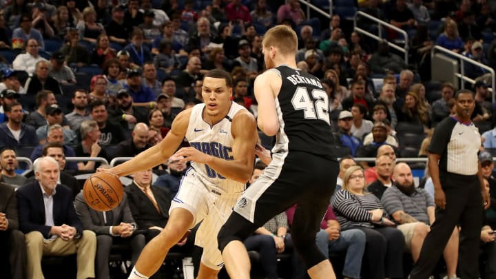 ORLANDO, FLORIDA – DECEMBER 19: Aaron Gordon #00 of the Orlando Magic drives against by Davis Bertans #42 of the San Antonio Spurs during the game at Amway Center on December 19, 2018 in Orlando, Florida. (Photo by Sam Greenwood/Getty Images)