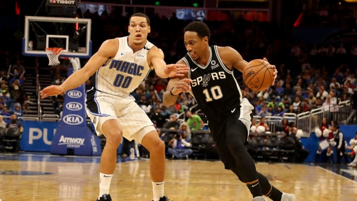ORLANDO, FLORIDA – DECEMBER 19: DeMar DeRozan #10 of the San Antonio Spurs drives against Aaron Gordon #00 of the Orlando Magic during the game at Amway Center on December 19, 2018 in Orlando, Florida. (Photo by Sam Greenwood/Getty Images)