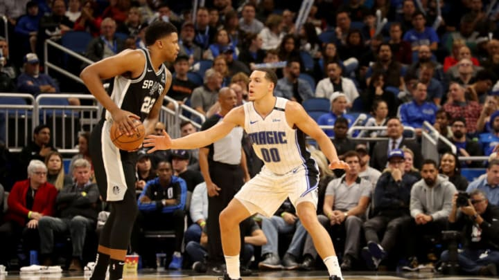ORLANDO, FLORIDA - DECEMBER 19: Rudy Gay #22 of the San Antonio Spurs is defended by Aaron Gordon #00 of the Orlando Magic during the game at Amway Center on December 19, 2018 in Orlando, Florida. NOTE TO USER: User expressly acknowledges and agrees that, by downloading and or using this photograph, User is consenting to the terms and conditions of the Getty Images License Agreement. (Photo by Sam Greenwood/Getty Images)