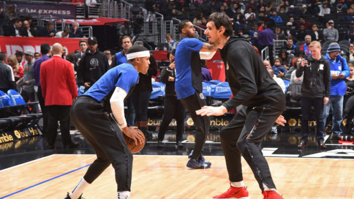 LOS ANGELES, CA - JANUARY 14 : Tobias Harris #34 and Boban Marjanovic #51 of the LA Clippers warm up prior to the game against the New Orleans Pelicans on January 14, 2019 at STAPLES Center in Los Angeles, California. NOTE TO USER: User expressly acknowledges and agrees that, by downloading and/or using this Photograph, user is consenting to the terms and conditions of the Getty Images License Agreement. Mandatory Copyright Notice: Copyright 2019 NBAE (Photo by Andrew D. Bernstein/NBAE via Getty Images)