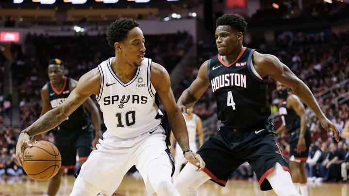 HOUSTON, TEXAS – DECEMBER 22: DeMar DeRozan #10 of the San Antonio Spurs attempts to drive baseline on Danuel House Jr. #4 of the Houston Rockets at Toyota Center on December 22, 2018 in Houston, Texas. (Photo by Bob Levey/Getty Images)