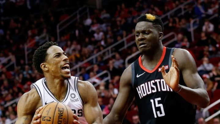 HOUSTON, TEXAS - DECEMBER 22: DeMar DeRozan #10 of the San Antonio Spurs drives past Clint Capela #15 of the Houston Rockets at Toyota Center on December 22, 2018 in Houston, Texas. NOTE TO USER: User expressly acknowledges and agrees that, by downloading and or using this photograph, User is consenting to the terms and conditions of the Getty Images License Agreement. (Photo by Bob Levey/Getty Images)