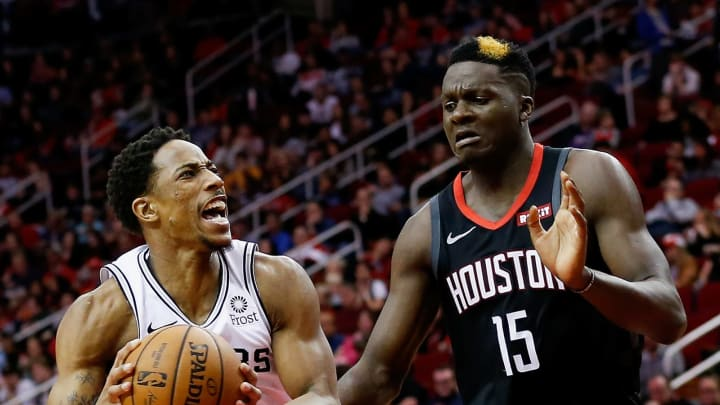 HOUSTON, TEXAS – DECEMBER 22: DeMar DeRozan #10 of the San Antonio Spurs drives past Clint Capela #15 of the Houston Rockets at Toyota Center on December 22, 2018 in Houston, Texas. (Photo by Bob Levey/Getty Images)