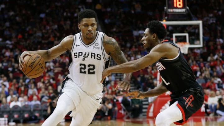 HOUSTON, TEXAS - DECEMBER 22: Rudy Gay #22 of the San Antonio Spurs drives on Brandon Knight #2 of the Houston Rockets during the second quarter at Toyota Center on December 22, 2018 in Houston, Texas. NOTE TO USER: User expressly acknowledges and agrees that, by downloading and or using this photograph, User is consenting to the terms and conditions of the Getty Images License Agreement. (Photo by Bob Levey/Getty Images)