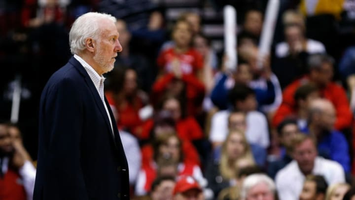 HOUSTON, TEXAS - DECEMBER 22: Head coach Gregg Popovich looks on during the fourth quarter against the Houston Rockets at Toyota Center on December 22, 2018 in Houston, Texas. NOTE TO USER: User expressly acknowledges and agrees that, by downloading and or using this photograph, User is consenting to the terms and conditions of the Getty Images License Agreement. (Photo by Bob Levey/Getty Images)