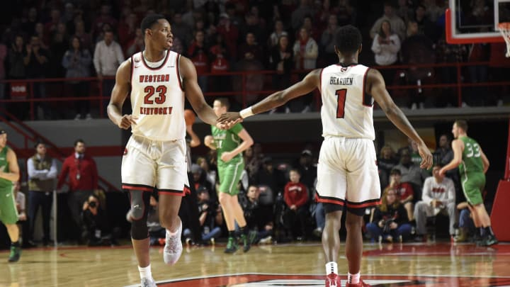 BOWLING GREEN, KY – JANUARY 21: Western Kentucky Hilltoppers center Charles Bassey (23) and Western Kentucky Hilltoppers guard Taveion Hollingsworth (11) against the Marshall Thundering Herd during a college basketball game in Bowling Green, KY. (Photo by Steve Roberts/Icon Sportswire via Getty Images)