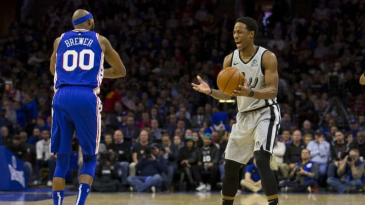 PHILADELPHIA, PA - JANUARY 23: Corey Brewer #00 of the Philadelphia 76ers and DeMar DeRozan #10 of the San Antonio Spurs react after a travel was called on DeRozan in the second quarter at the Wells Fargo Center on January 23, 2019 in Philadelphia, Pennsylvania. NOTE TO USER: User expressly acknowledges and agrees that, by downloading and or using this photograph, User is consenting to the terms and conditions of the Getty Images License Agreement. (Photo by Mitchell Leff/Getty Images)