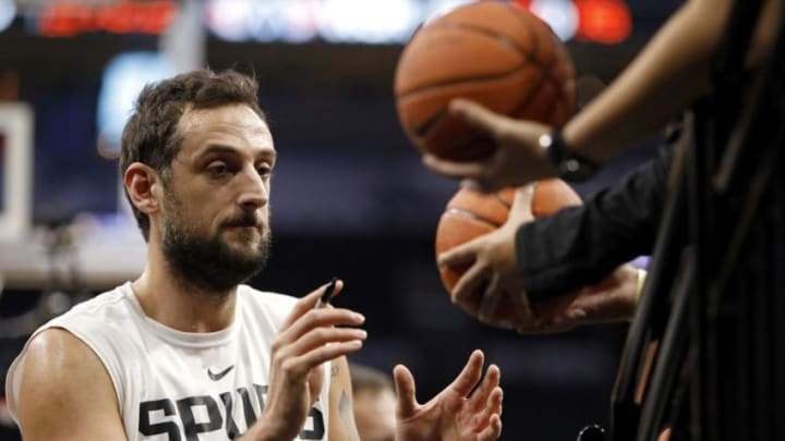 SAN ANTONIO, TX - JANUARY 27: Marco Belinelli #18 of the San Antonio Spurs signs autographs before an NBA game against the Washington Wizards held January 27, 2019 at the AT&T Center in San Antonio, Texas. NOTE TO USER: User expressly acknowledges and agrees that, by downloading and or using this photograph, User is consenting to the terms and conditions of the Getty Images License Agreement. (Photo by Edward A. Ornelas/Getty Images)