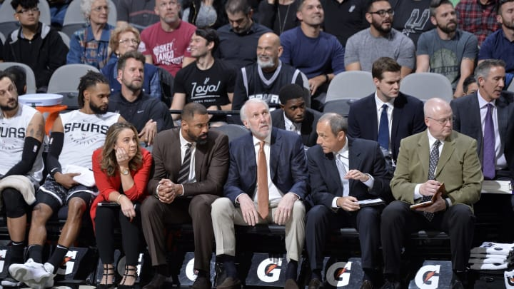 SAN ANTONIO, TX – JANUARY 27: Assistant Coach Becky Hammon, Assistant Coach Ime Udoka, Head Coach Gregg Popovich, and Assistant Coach Ettore Messina of the San Antonio Spurs look on during the game against the Washington Wizards (Photo by Mark Sobhani/NBAE via Getty Images)