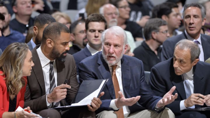 SAN ANTONIO, TX - JANUARY 27: Assistant Coach Becky Hammon, Assistant Coach Ime Udoka, Head Coach Gregg Popovich, and Assistant Coach Ettore Messina of the San Antonio Spurs look on during the game against the Washington Wizards (Photo by Mark Sobhani/NBAE via Getty Images)