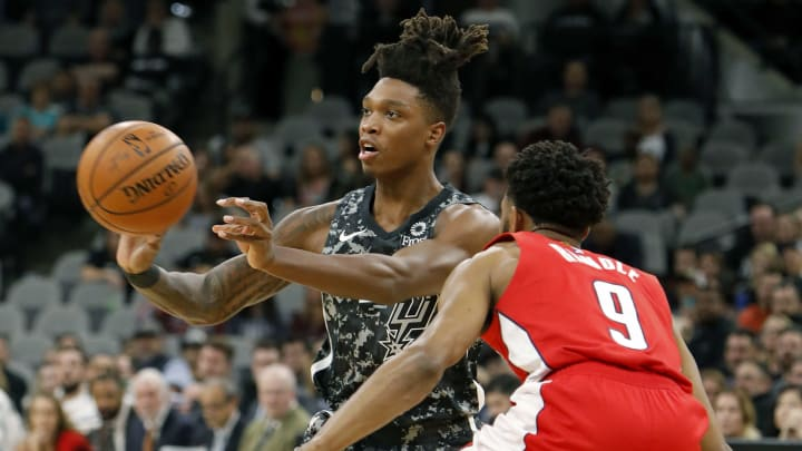 SAN ANTONIO, TX – JANUARY 27: Lonnie Walker IV #1 of the San Antonio Spurs passes around Chasson Randle #9 of the Washington Wizards during an NBA game held January 27, 2019 at the AT&T Center in San Antonio, Texas. The Spurs won 132-119. (Photo by Edward A. Ornelas/Getty Images)