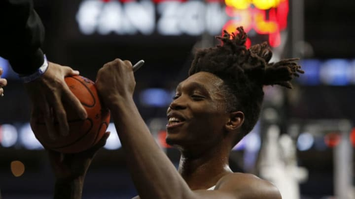 SAN ANTONIO, TX - JANUARY 29: Lonnie Walker IV #1 of the San Antonio Spurs sings autographs before an NBA game against the Phoenix Suns (Photo by Edward A. Ornelas/Getty Images)