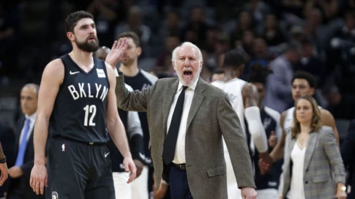 SAN ANTONIO, TX - JANUARY 31: Gregg Popvich head coach of the San Antonio Spurs reacts during game as Joe Harris #12 of the Brooklyn Nets heads to his bench at AT&T Center. (Photo by Ronald Cortes/Getty Images)