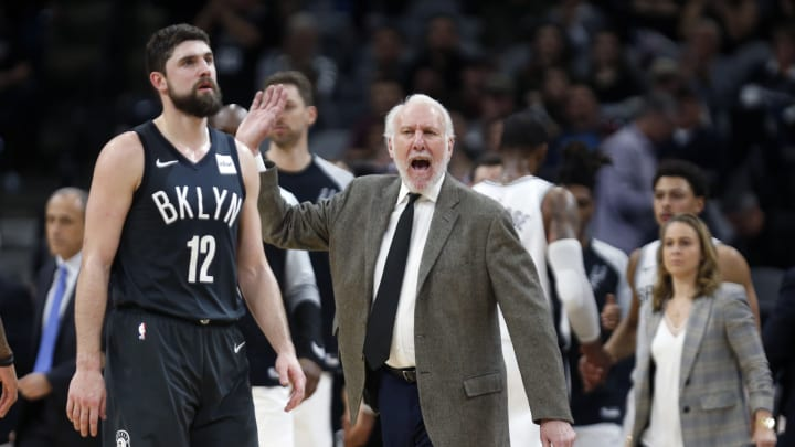 SAN ANTONIO, TX – JANUARY 31: Gregg Popovich head coach of the San Antonio Spurs reacts during the game as Joe Harris #12 of the Brooklyn Nets heads to his bench at AT&T Center. (Photo by Ronald Cortes/Getty Images)