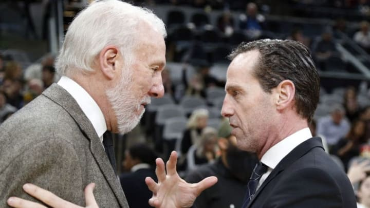 SAN ANTONIO, TX - JANUARY 31: Gregg Popovich head coach of the San Antonio Spurs,L, meets with Kenny Atkinson of the Brooklyn Nets before the start of their game at AT&T Center on January 31, 2019 in San Antonio, Texas. NOTE TO USER: User expressly acknowledges and agrees that , by downloading and or using this photograph, User is consenting to the terms and conditions of the Getty Images License Agreement. (Photo by Ronald Cortes/Getty Images)