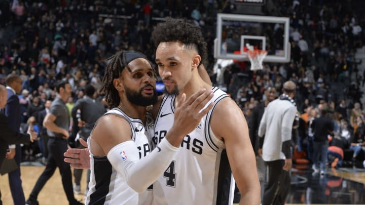 SAN ANTONIO, TX – JANUARY 31: Patty Mills #8 of the San Antonio Spurs hugs Derrick White #4 of the San Antonio Spurs after the game against the Brooklyn Nets on January 31, 2019 at the AT&T Center in San Antonio, Texas. (Photos by Mark Sobhani/NBAE via Getty Images)