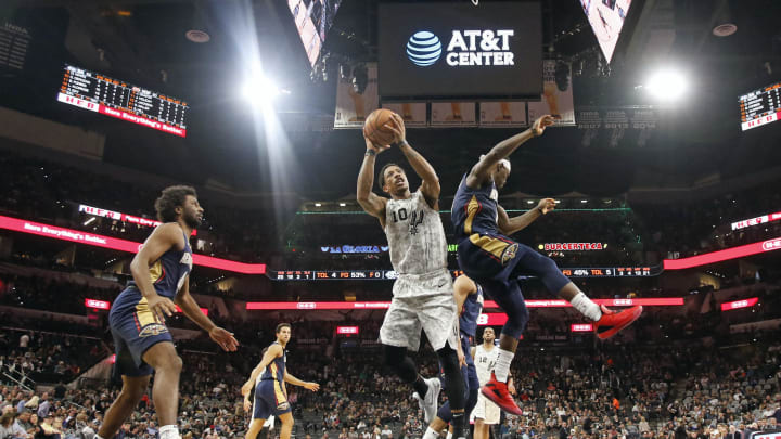 SAN ANTONIO, TX – FEBRUARY 2: DeMar DeRozan #10 of the San Antonio Spurs shoots past Jrue Holiday #11 of the New Orleans Pelicans at AT&T Center. (Photo by Ronald Cortes/Getty Images)