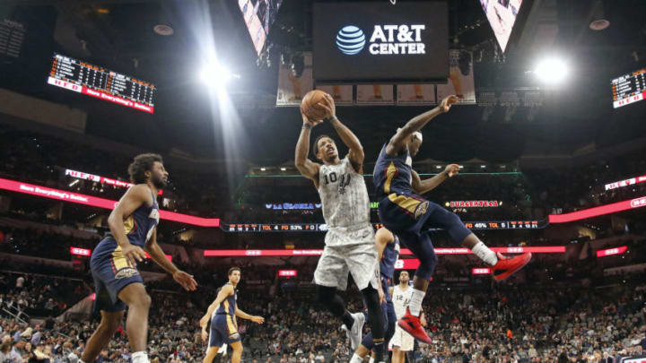 SAN ANTONIO, TX - FEBRUARY 2: DeMar DeRozan #10 of the San Antonio Spurs shoots past Jrue Holiday #11 of the New Orleans Pelicans at AT&T Center. (Photo by Ronald Cortes/Getty Images)