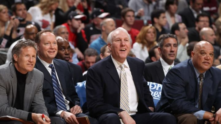 CHICAGO, IL - FEBRUARY 17: San Antonio Spurs head coach Gregg Popovich (3rd L) watches from the bench with assistant coaches Mike Budenholzer (2nd L) and Don Newman (R) during the game against the Chicago Bulls on February 17, 2011 at the United Center in Chicago, Illinois. NOTE TO USER: User expressly acknowledges and agrees that, by downloading and or using this Photograph, user is consenting to the terms and conditions of the Getty Images License Agreement. Mandatory Copyright Notice: Copyright 2011 NBAE (Photo by Gary Dineen/NBAE via Getty Images)