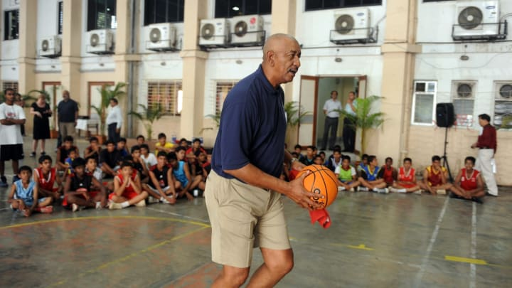 Legendary San Antonio Spurs guard George 'The Iceman' Gervin gives some tips to Indian schoolchildren during a basketball coaching clinic in Mumbai (PUNIT PARANJPE/AFP via Getty Images)