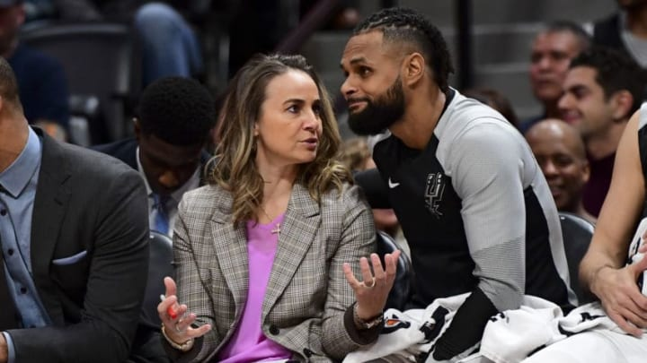DENVER, CO - DECEMBER 28: Becky Hammon and Patty Mills #8 of the San Antonio Spurs talk on the bench during the game against the Denver Nuggets (Photo by Justin Tafoya/Getty Images)