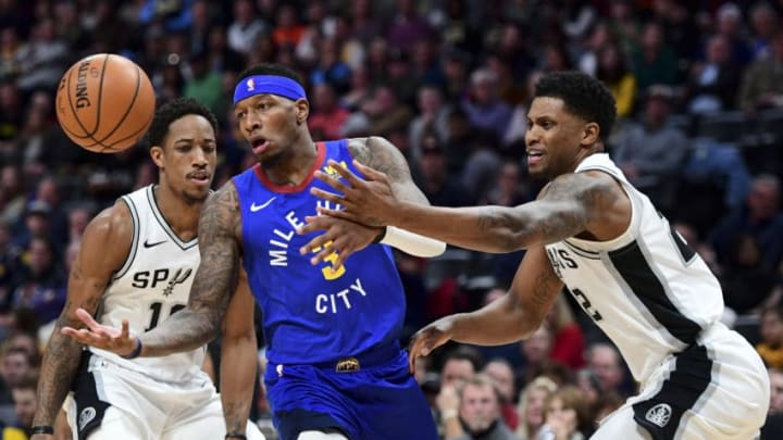 DENVER, CO - DECEMBER 28: Torrey Craig #3 of the Denver Nuggets and Rudy Gay #22 of the San Antonio Spurs compete for a loose ball at Pepsi Center on December 28, 2018 in Denver, Colorado. NOTE TO USER: User expressly acknowledges and agrees that, by downloading and or using this photograph, User is consenting to the terms and conditions of the Getty Images License Agreement. (Photo by Justin Tafoya/Getty Images)