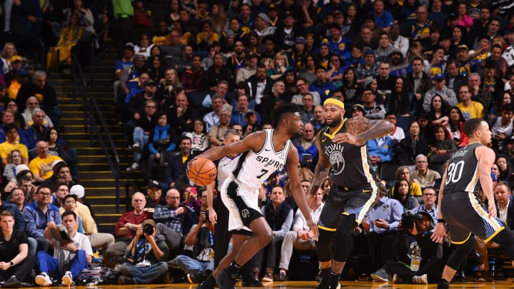 OAKLAND, CA – FEBRUARY 6: Chimezie Metu #7 of the San Antonio Spurs handles the ball against the Golden State Warriors on February 6, 2019 (Photo by Noah Graham/NBAE via Getty Images)