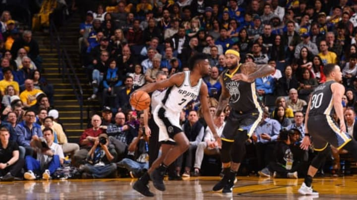 OAKLAND, CA – FEBRUARY 6: Chimezie Metu #7 of the San Antonio Spurs handles the ball against the Golden State Warriors on February 6, 2019 at ORACLE Arena in Oakland, California. NOTE TO USER: User expressly acknowledges and agrees that, by downloading and or using this photograph, user is consenting to the terms and conditions of Getty Images License Agreement. Mandatory Copyright Notice: Copyright 2019 NBAE (Photo by Noah Graham/NBAE via Getty Images)
