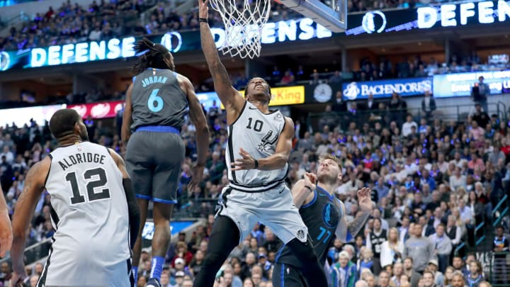 DALLAS, TEXAS – JANUARY 16: DeMar DeRozan #10 of the San Antonio Spurs drives to the basket against DeAndre Jordan #6 of the Dallas Mavericks in the second half at American Airlines Center on January 16, 2019 in Dallas, Texas. (Photo by Tom Pennington/Getty Images)