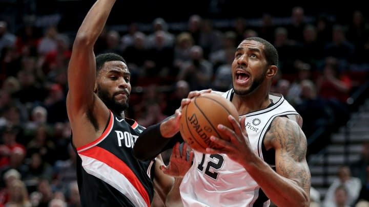 PORTLAND, OR – FEBRUARY 07: LaMarcus Aldridge #12 of the San Antonio Spurs works against Maurice Harkless #4 of the Portland Trail Blazers in the first quarter during their game at Moda Center (Photo by Abbie Parr/Getty Images)