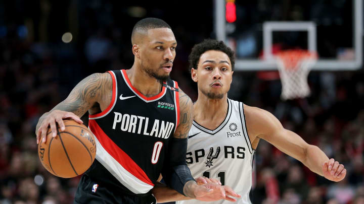 PORTLAND, OR – FEBRUARY 07: Damian Lillard #0 of the Portland Trail Blazers dribbles against Bryn Forbes #11 of the San Antonio Spurs (Photo by Abbie Parr/Getty Images)