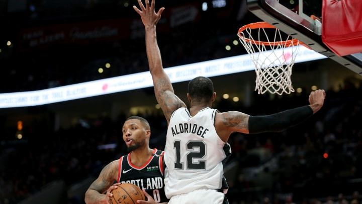 PORTLAND, OR – FEBRUARY 07: Damian Lillard #0 of the Portland Trail Blazers looks to pass the ball against LaMarcus Aldridge #12 of the San Antonio Spurs in the fourth quarter during their game at Moda Center on February 7, 2019 in Portland, Oregon. (Photo by Abbie Parr/Getty Images)